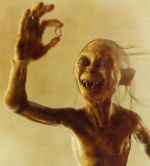 129 - Gollum holding up the ring